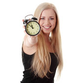 Woman showing alarm clock — Stock Photo