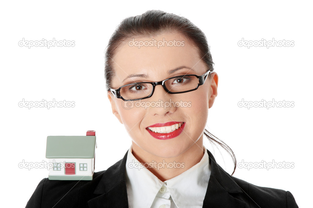 Young beautiful business woman with house model - real estate concept. Isolated on white — Stock Photo #4996653
