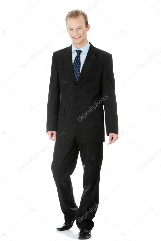 Full length portrait of a handsome businessman standing against white background  — Stock Photo #4997827