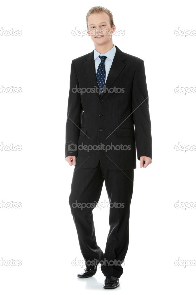 Full length portrait of a handsome businessman standing against white background  — Stock Photo #4997828