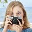 Pretty girl making photo — Stock Photo
