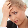 Business woman with headache — Stock Photo