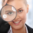 Business woman looking into a magnifying glass — Stock Photo #5005877