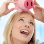 Businesswoman holding piggy bank — Stock Photo