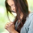 Young caucasian woman praying — Stock Photo #5007044