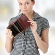 Stock Photo: Young caucasiwomwith empty wallet - broke