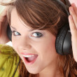 Beautiful teenage girl listening to music — Foto Stock