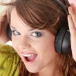 Beautiful teenage girl listening to music — Stock Photo