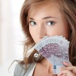 Happy young woman holding money — Stock Photo #5008446