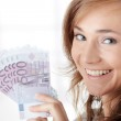 Happy young woman holding money — Stock Photo #5008447