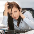 Stock Photo: Exhausted female filling out tax forms