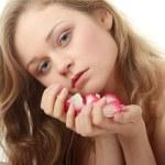 Beautiful face and rose-petal — Stock Photo #5009742