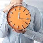 Woman holding big alarm clock — Stock Photo #5009861