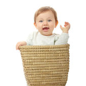 Young baby girl in basket — Stock Photo