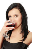 Beautiful woman with glass red wine — Stock Photo