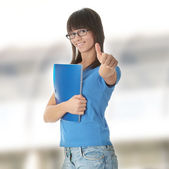 Teen student girl with note pad — Stock Photo