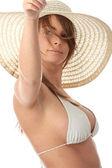 Pretty tanned brunette in bikini with hat — Stock Photo
