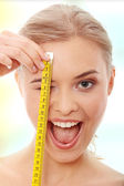 Beautiful woman measuring her body — Stock Photo