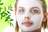 Young female face with clay mask — Стоковое фото