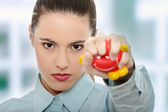 Young businesswoman holding heart shaped toy — Stock Photo
