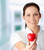 Young nurse with heart — Stock Photo