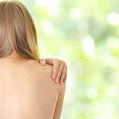 Pain in her back — Stock Photo