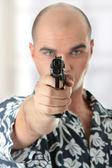 Men with gun — Stock Photo