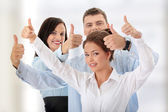 Business team with thumbs up — Stock Photo