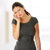Young business woman with headache — Stockfoto