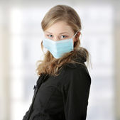A model wearing a mask to prevent 'Swine Flu' infection. — Stock Photo