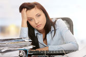 Exhausted female filling out tax forms — Stock Photo
