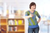 Young student woman with thumb up — Stock Photo