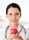 Young doctor with heart — Stock Photo