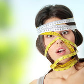 Woman with measuring tape around her head — Foto de Stock