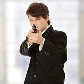 Businessman aiming with handgun — Stock Photo