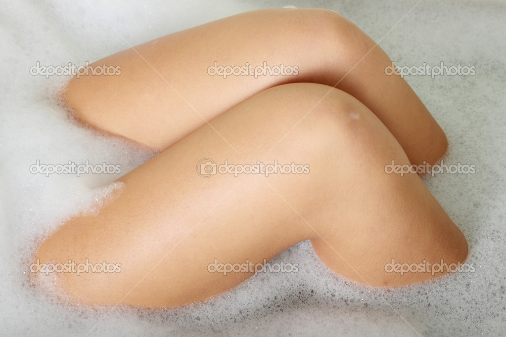 Legs of beautiful young caucasian female in bath — Stock Photo #5007078