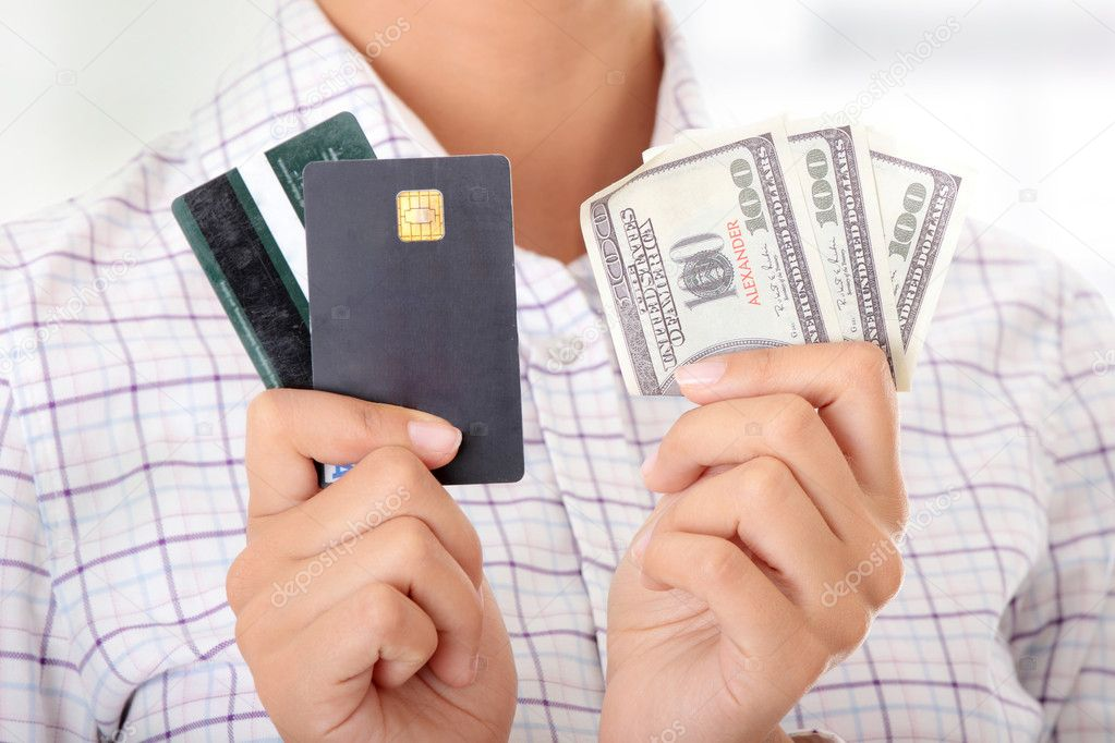 Woman with a credit card and cash on her hand  Stock Photo #5007474