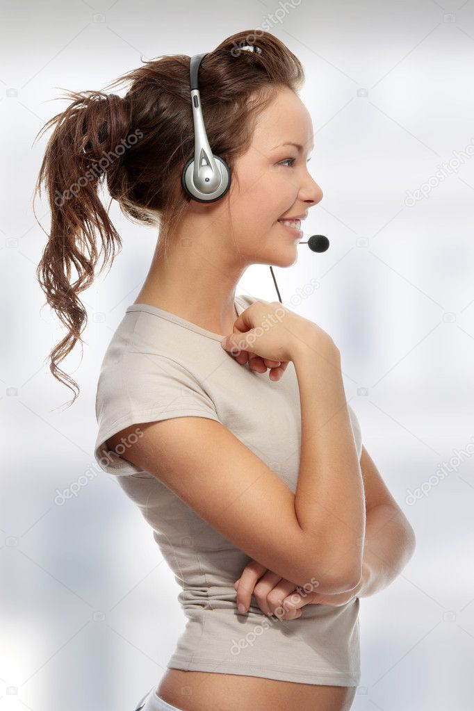 Beautiful Call Center Woman Wearing A Telephone Headset  Stock Photo #5008135