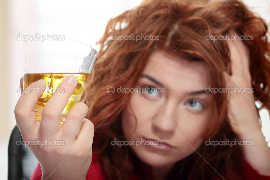 Alone young woman in depression, drinking alcohol (burbon)  Stock Photo #5008423