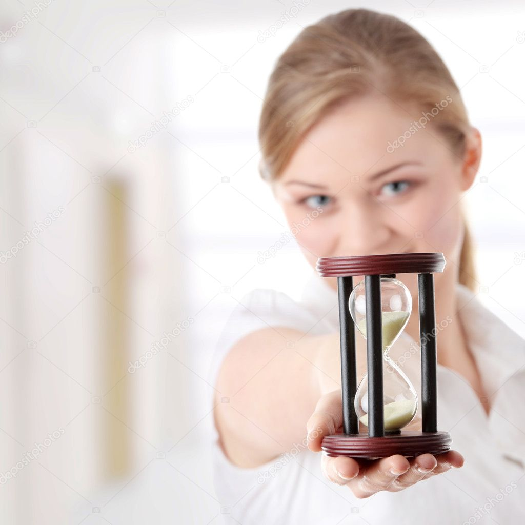 Young business woman with hourglass - time concept — Stock Photo #5008497