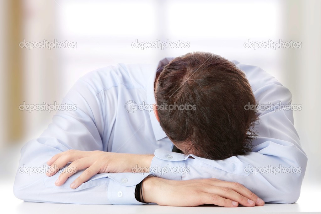 Businessman in depression with hand on forehead — Stock Photo #5008737