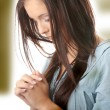 Royalty-Free Stock Photo: Young caucasian woman praying