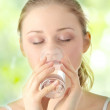 Young woman drinking fresh cold water — Stock Photo