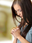 Young caucasian woman praying — Stock Photo