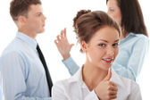 Young businesswoman with thumbs up — Stock Photo