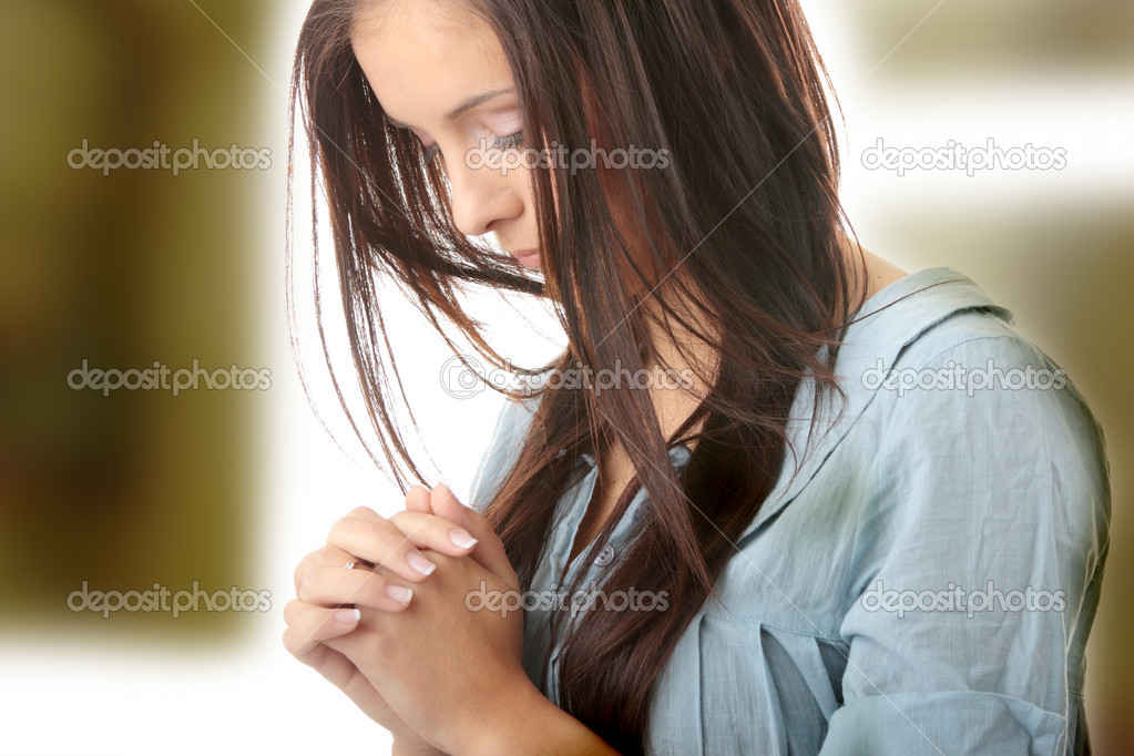 Closeup portrait of a young caucasian woman praying  — Stock Photo #5010288