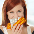 Stock Photo: Young woman with pills