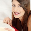Beautiful woman reading a book — Stock Photo #5065078