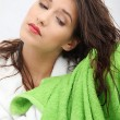 Beautiful young woman wipes her hairs — Stock Photo