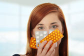 Young woman with pills — Stock Photo